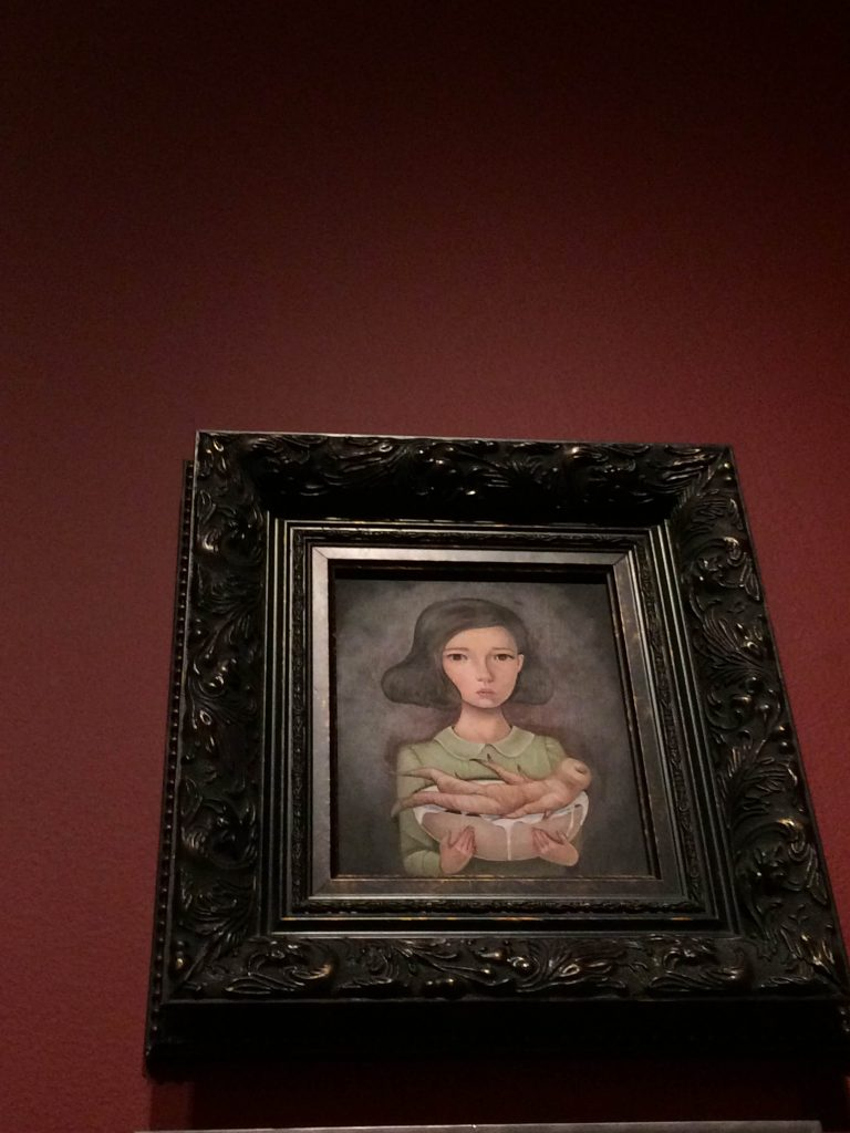 girl with a horseradish, painting in a gilt frame
