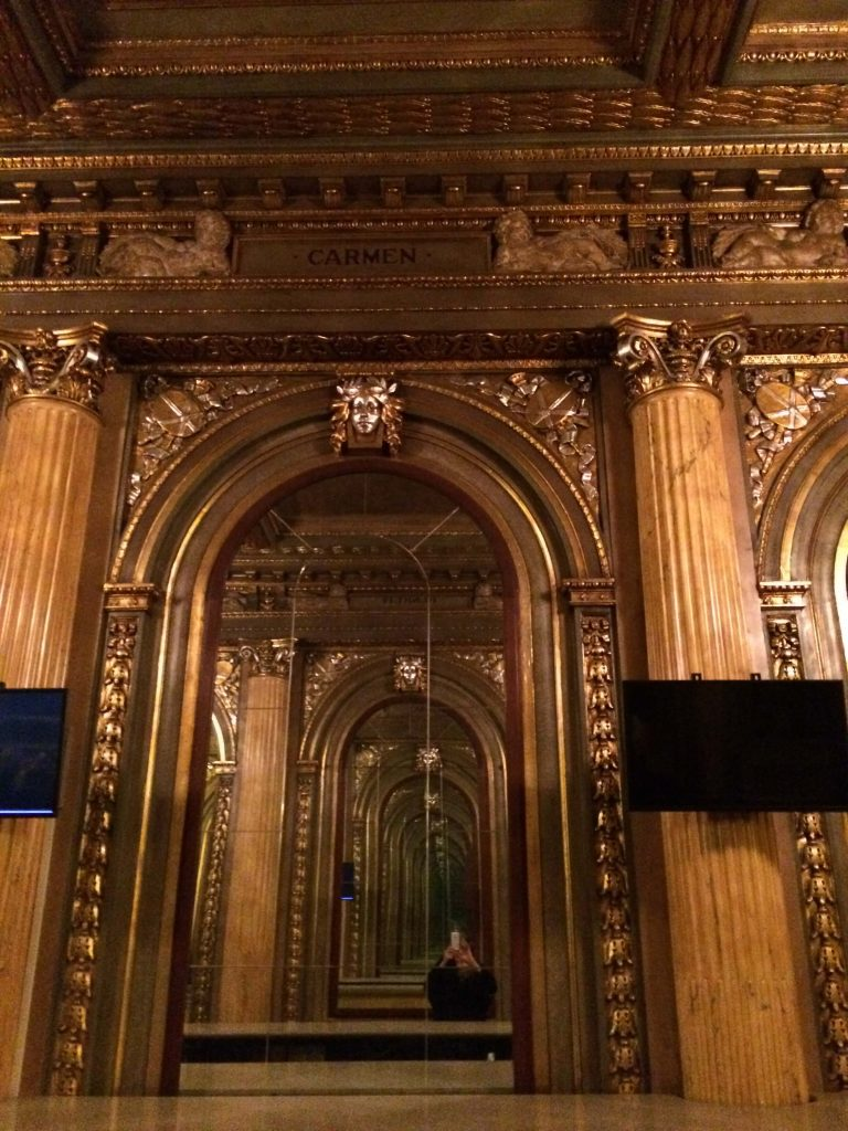 gilded mirrors in a theatre